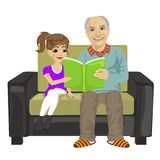Grandfather and granddaughter sitting on the sofa and reading book Stock Images