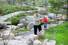 Grandfather and granddaughter in a spring park Stock Image