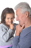 Grandfather and granddaughter thinking about something Stock Photos