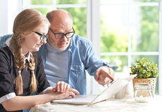 Grandfather and  granddaughter using laptop Stock Images