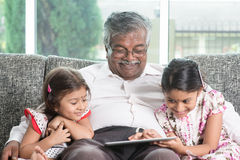 Grandfather and granddaughter using modern technology Stock Images
