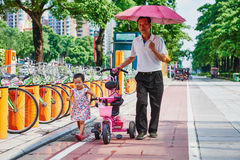 Asia Chinese family grandfather and granddaughter walk on road Royalty Free Stock Photography