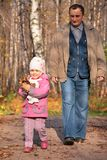 Grandfather with  granddaughter walk on wooden Royalty Free Stock Photography
