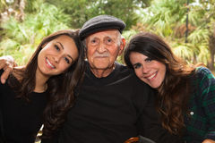 Grandfather and Granddaughters Stock Photos