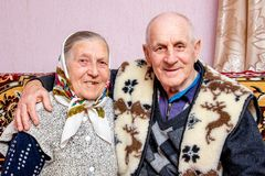 Grandfather and grandmother embraced, they have a holiday - gol stock photo