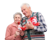 Grandfather and grandmother with gifts Stock Images