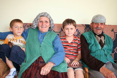 Grandfather, grandmother and grandchilderen. Grandfather, grandmother and two grandchildren -smiling and happy Stock Image