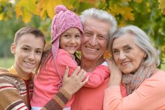 Grandfather, grandmother  and grandchildren    in park Royalty Free Stock Photos