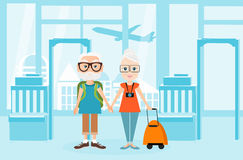 Grandfather and grandmother with a packsack travel. Travelling with the knapsack. Background of airport interiors Royalty Free Stock Photography