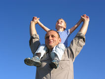 Grandfather with grandson. On blue sky stock photo