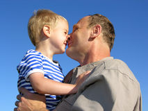 Grandfather with grandson. Kiss by nose royalty free stock photo