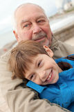 Grandfather and grandson. Portrait of grandfather and grandson outdoors Stock Photos