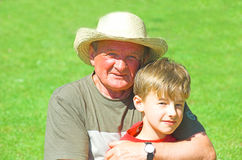 Grandfather with grandson Stock Images
