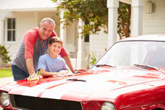 Grandfather And Grandson Cleaning Restored Classic Car Royalty Free Stock Photo