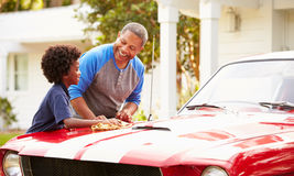 Grandfather And Grandson Cleaning Restored Classic Car Royalty Free Stock Photos