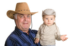 Grandfather and grandson in a cowboy hat. Stock Photography