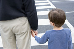 Grandfather and grandson at a crosswalk Royalty Free Stock Photos