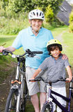 Grandfather And Grandson On Cycle Ride In Countryside Royalty Free Stock Photography