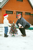 Grandfather and grandson  decorate a Christmas tree Royalty Free Stock Photo