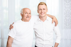 Grandfather and grandson embracing each other Stock Photos