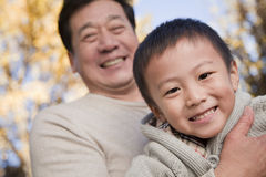 Grandfather and Grandson Enjoying in the Park Stock Photography