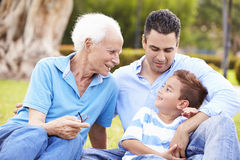 Grandfather With Grandson And Father In Park Stock Photography