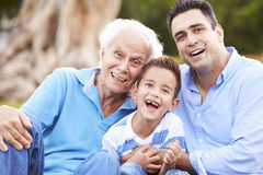 Grandfather With Grandson And Father In Park Royalty Free Stock Images