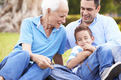 Grandfather With Grandson And Father In Park Stock Photos