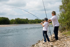 Grandfather and grandson fishing Royalty Free Stock Photography