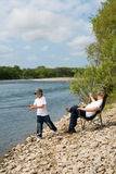 Grandfather and grandson fishing Royalty Free Stock Images