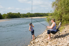 Grandfather and grandson fishing Stock Image