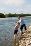 Grandfather and grandson fishing Stock Photos
