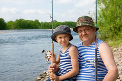 Grandfather grandson fishing Stock Photo