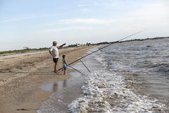 Grandfather and grandson fishing Royalty Free Stock Image