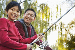Grandfather and grandson fishing portrait Stock Photo