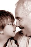 Grandfather grandson forehead. Over white background Royalty Free Stock Image