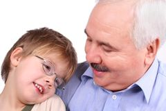 Grandfather grandson forehead. Over white background Stock Image