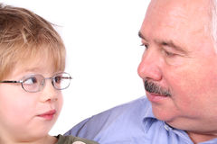 Grandfather grandson forehead. Over white background Stock Photography