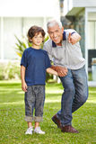Grandfather with grandson in garden Royalty Free Stock Photography