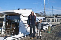 Grandfather and grandson has checked the boat Royalty Free Stock Photo