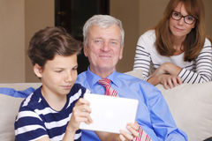 Grandfather and grandson having fun Royalty Free Stock Photos