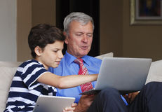 Grandfather and grandson at home Royalty Free Stock Photo