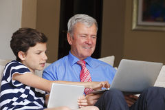 Grandfather and grandson at home Stock Photos