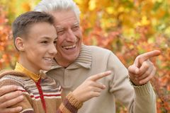 Grandfather and grandson hugging  in park Royalty Free Stock Photography