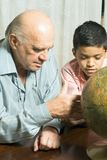 Grandfather and Grandson Look at a Globe - Vertica stock photo
