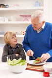 Grandfather And Grandson Making Sandwich Stock Photography