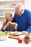 Grandfather And Grandson Making Sandwich Stock Photo