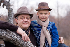 Grandfather and grandson outdoors. Royalty Free Stock Photo