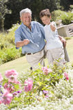 Grandfather and grandson outdoors in garden Royalty Free Stock Photo