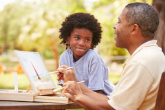 Grandfather With Grandson Outdoors Painting Landscape stock images